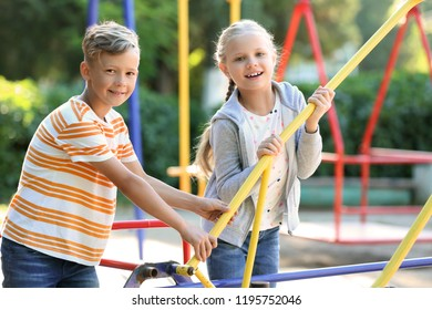 Cute little children outdoors on playground