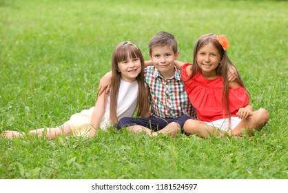 Cute little children in park on summer day