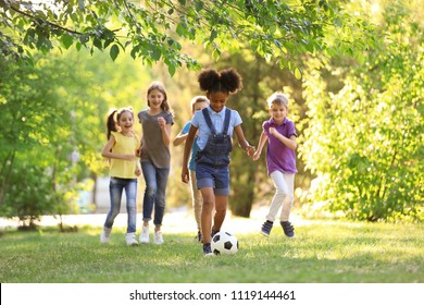Cute little children playing with ball outdoors on sunny day