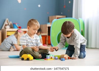Cute little children playing in kindergarten