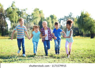 Cute little children playing outdoors