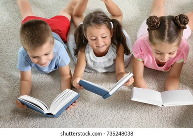 Cute little children reading books indoors