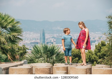 Cute little children tourists admiring Barcelona city from Montjuic hill, travel with kids