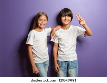 Cute little children in t-shirts on color background