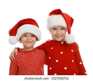Cute little children wearing Santa hats on white background. Christmas holiday