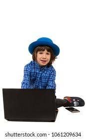 Cute little executive child boy typing on laptop and sitting down isolated on white background