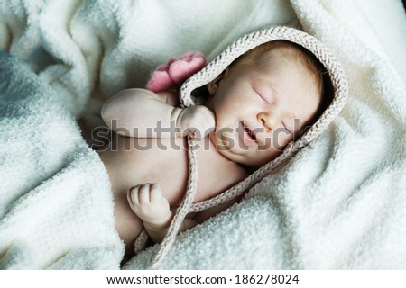 cute little funny sleeping baby with hat