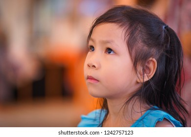 Cute little girl absent minded.