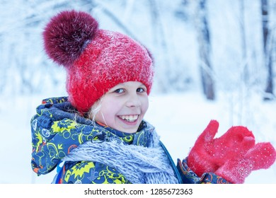 cute little girl baby in winter clothes walking in the snow