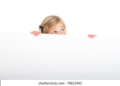 cute little girl behind white board with funny facial expression
