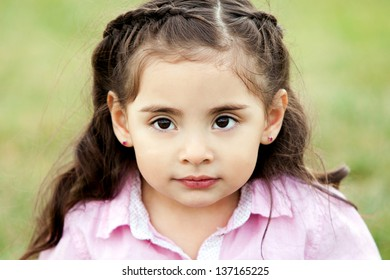 Cute little girl with big brown eyes
