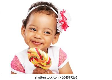 Cute little girl with a big lollipop