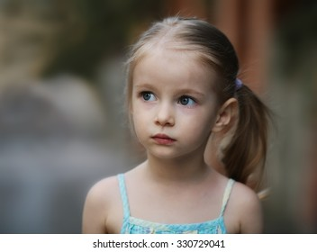 Cute little girl in blue