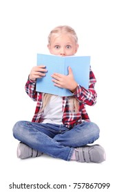 Cute little girl with book on white background