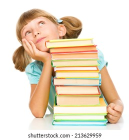Cute little girl with books, isolated over white