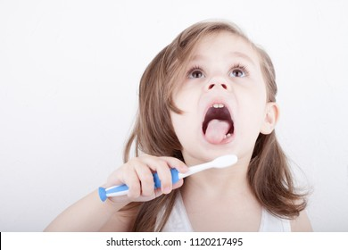 Cute little girl brushing his teeth