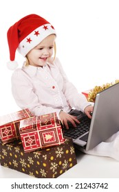 cute little girl buying christmas gifts on the internet