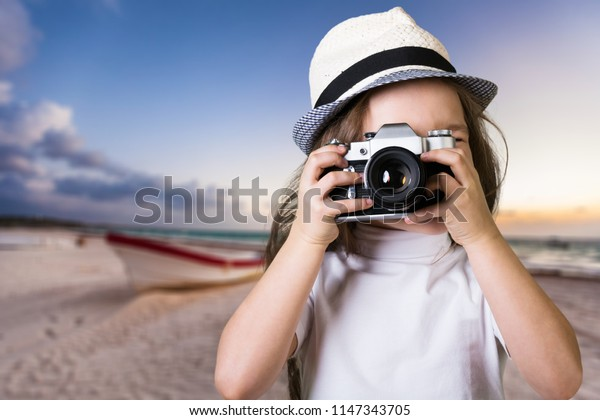 Cute little girl with camera
