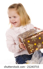 cute little girl with christmas gift
