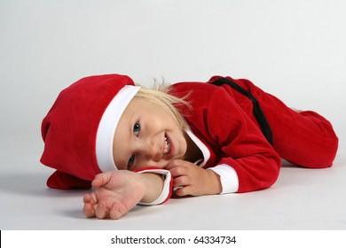 Cute little girl in Christmas hat and dress