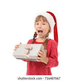 Cute little girl with Christmas present on white background