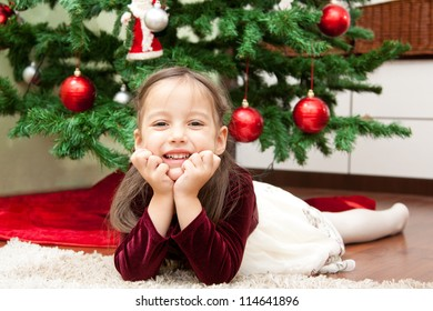 cute little girl with christmas tree
