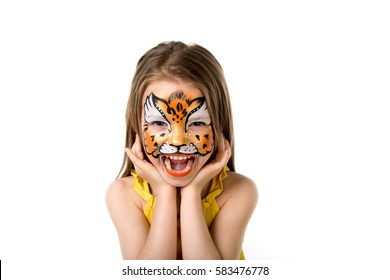 cute little girl with colorful painted face like tiger