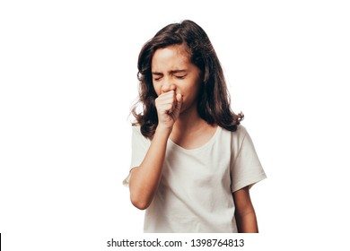 Cute little girl is coughing, on white background