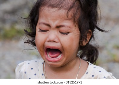 Cute little girl is crying
