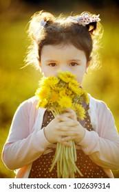 cute little girl with dandelions