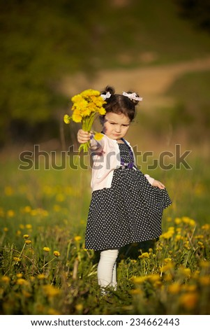 cute little girl with dandelions