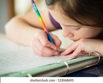 Cute little girl doing her homework