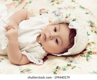 Cute little girl in dress and hat