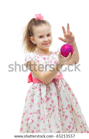 565a41bc12f7 Cute little girl in dress playing with a christmas-tree decoration on white  background isolated