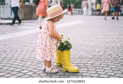 Cute little girl in dress walking in european city at spring or summer time. Beautiful child spend time in old town of Ljubljana, Slovenia. Streets of Europe