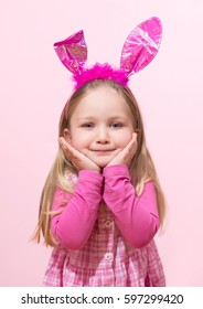 Cute little girl dressed up like a bunny is posing