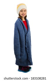 Cute little girl dressed in oversized cardigan buttonned in a wrong way, isolated