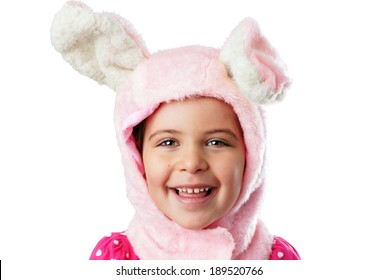 Cute little girl dressed up as pink bunny smiling ans laughing