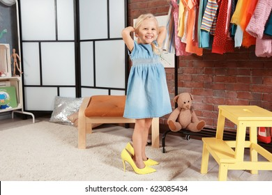 Cute little girl in dressing room