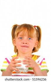 Cute little girl is drinking milk