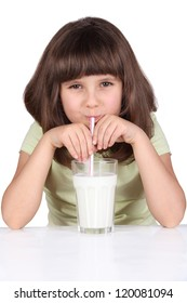 Cute little girl drinks milk using drinking straw, isolated on white