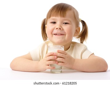 Cute little girl drinks milk, isolated over white