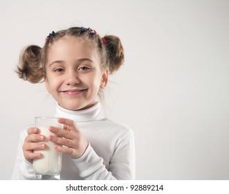 Cute little girl drinks milk