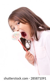cute little girl eating marshmallow sweet candy
