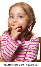 Cute little girl eating a slice of apple isolated over white background