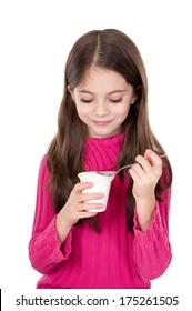 cute little girl eating yoghurt