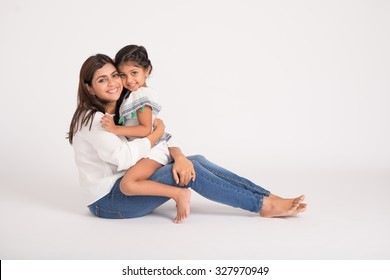 Cute little girl embracing her young mother