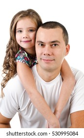 Cute little girl embracing her father isolated on a white