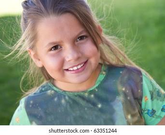 Cute little girl enjoying the outdoors
