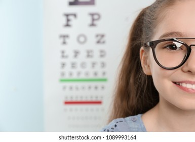 Cute little girl with eyeglasses in ophthalmologist office. Focus on face